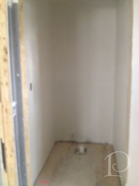 Gina master bath toilet room