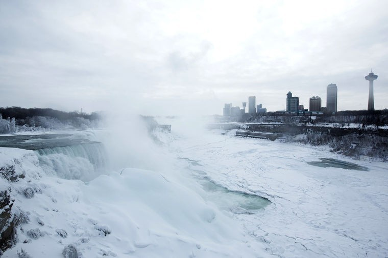 Image: A snow-covered landscape is seen over the frozen Niagara Falls in Niagara Falls, New York